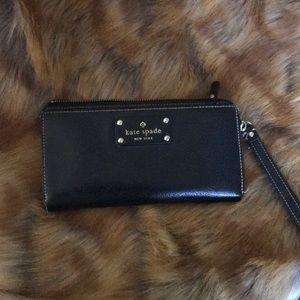 Black leather wristlet by Kate Spade